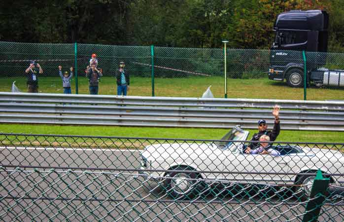 Mercede's Lewis Hamilton waves to the ground during the driver's parade